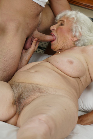 Granny Norma poses for the camera and seduces a guy to fuck her